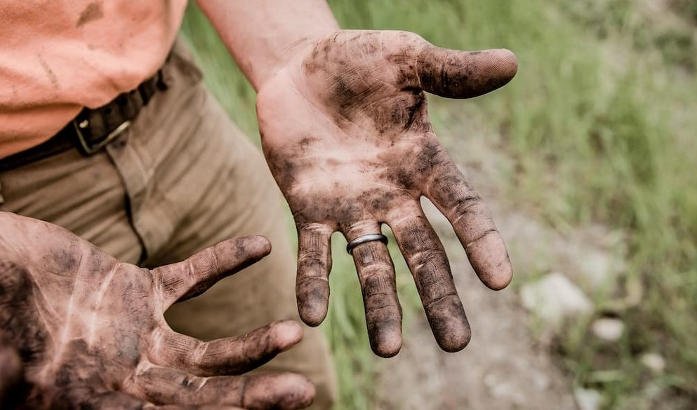 hard worker with dirty hands